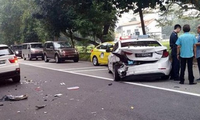Hoseh liao: BMW driver smashes right into back of police car along Evans Road