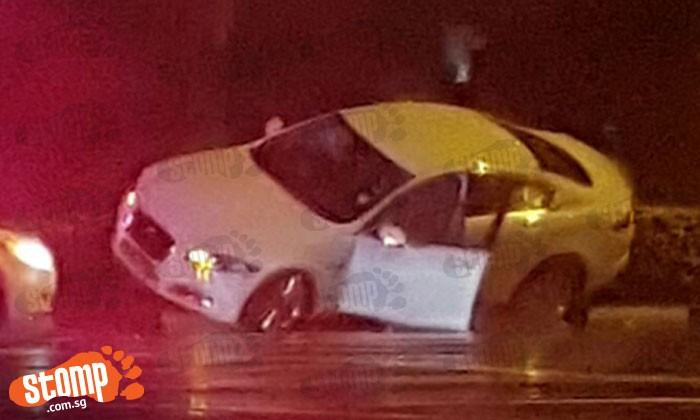 Car gets stuck on railing at Yio Chu Kang junction