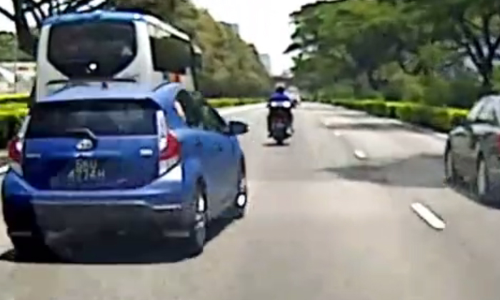 Look how close this driver comes to crashing after recklessly cutting across lanes