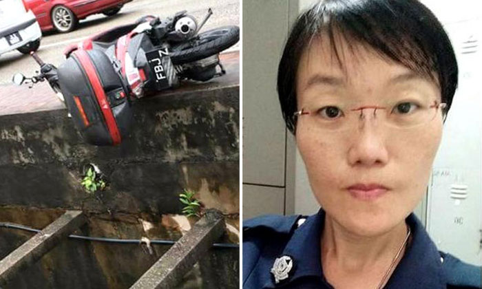 Auxiliary police officer dies after her motorcycle gets hit by another rider and she falls into drain in Johor