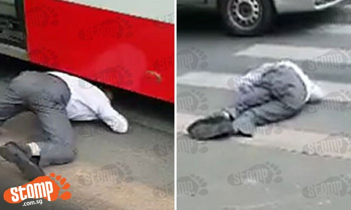 Shocking video: Man lunges under moving bus and lies motionless after being run over