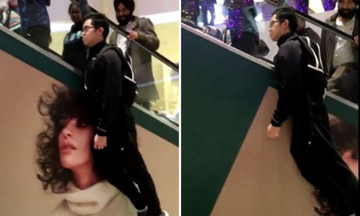 There is more than one way to go up an escalator -- and this guy shows you how