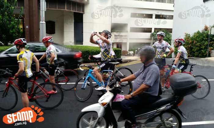 Group of cyclists hold up traffic by hogging middle lane at Tanglin Road