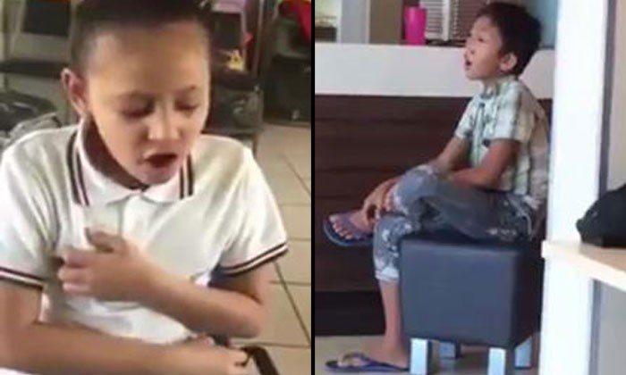Girl with disability sings Whitney Houston's song beautifully while boy at fast food restaurant belts out Celine Dion's hit
