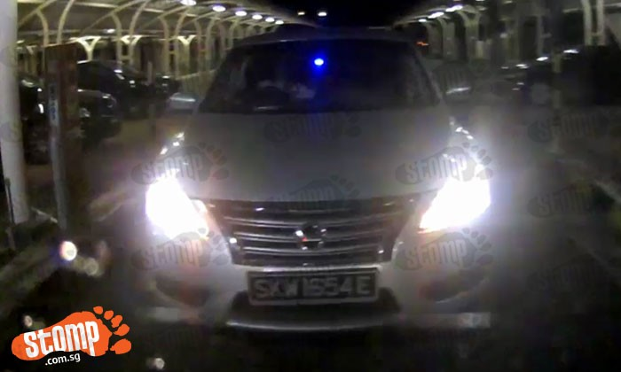 Nissan's driver signals to Stomper to exit -- then tailgates her to evade parking fee