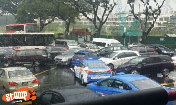 Total chaos at Yio Chu Kang Road junction after traffic lights stop working during heavy downpour