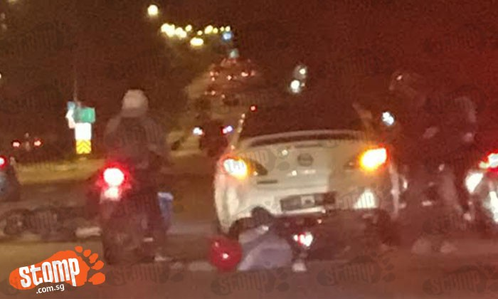 Mazda driver knocks down 2 motorcyclists on BKE