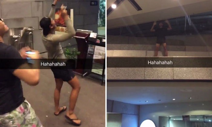 Boys make their own ZoukOut party as they cheer while one of them dances at a 2nd-storey ledge