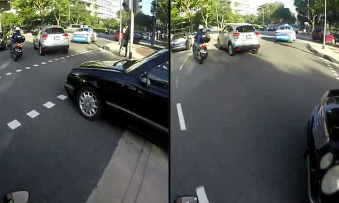 Merc driver almost knocks down biker after going straight on right-turn only lane