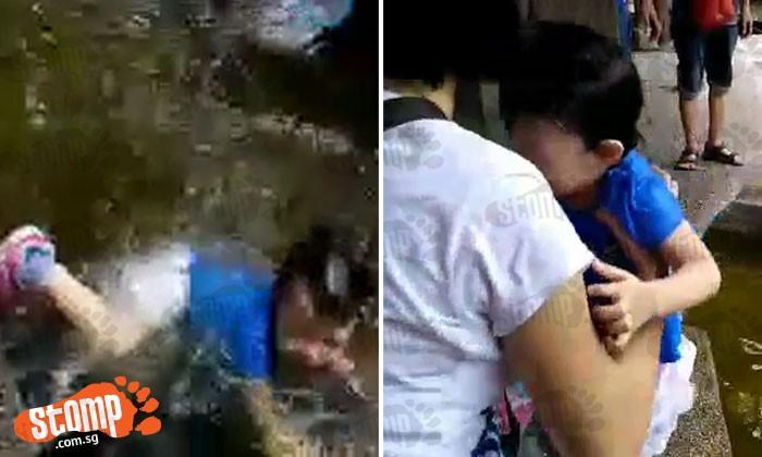 Girl falls into pond at fish farm -- and starts crying while soaking wet