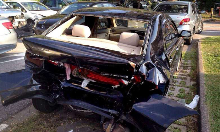 Lai Kum Tai, 40, tailgated and hit the Toyota Altis the boy was in on the Seletar Expressway (SLE) on June 11, 2014. PHOTO: TNP READER