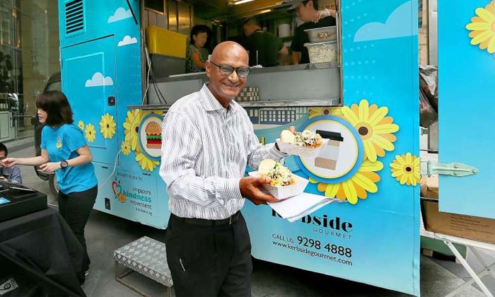 Lawyer Ajaib Haridass doing his bit to support the food drive yesterday.Photo by: Jonathan Choo (The Straits Times)