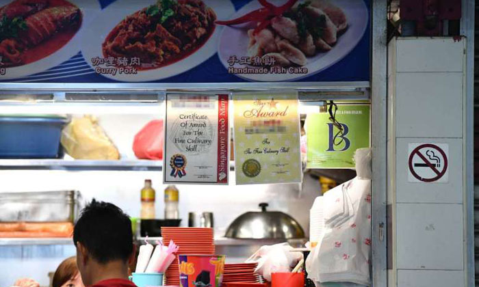 These certificates that some hawkers display at their stalls are not necessarily accolades for quality culinary skills, but advertisements instead. PHOTOS: LIM YAOHUI, SCREENGRAB FROM THE GREEN BOOK WEBSITE