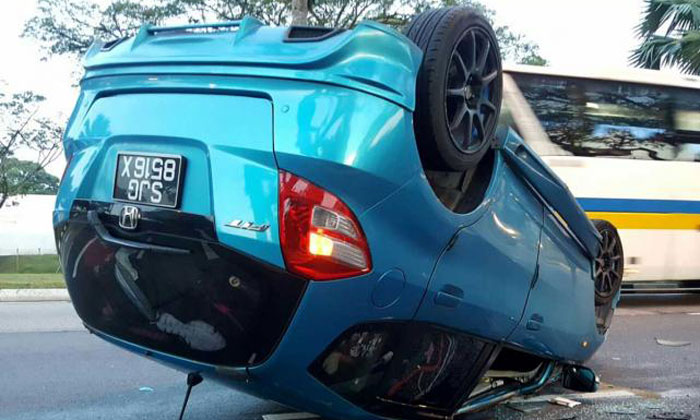 The blue Honda Fit was involved in an accident at 7.05am yesterday. PHOTO: COURTESY OF SHAWAL LATIB