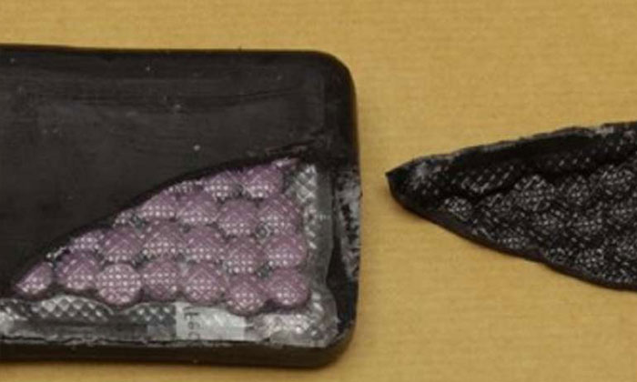 Tablets suspected to be controlled drugs, concealed within a wrapping made to appear like a bar of soap, recovered in a Central Narcotics Bureau operation on Feb 16, 2017.PHOTO: CENTRAL NARCOTICS BUREAU