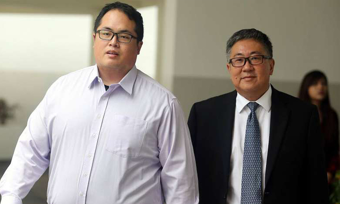 Jonathan Tan Huai En (left) and his father Senior Counsel Tan Chee Meng, leaving the State Courts on Feb 2, 2017. Photos: The Straits Times