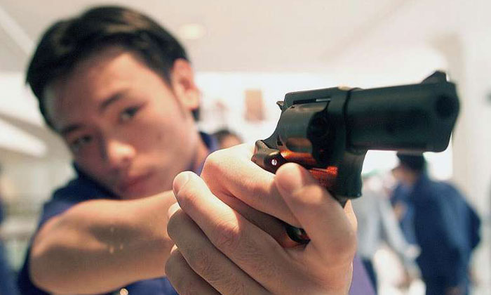 The Taurus M85 revolver officers use can hold five rounds of ammunition, but semi-automatic pistols can hold up to 17.PHOTO: LIANHE ZAOBAO FILE