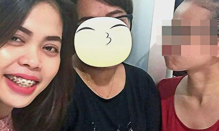 Cheerful and carefree: Siti Aisyah (left) posing with friends the night before the assassination. Photo: China Press