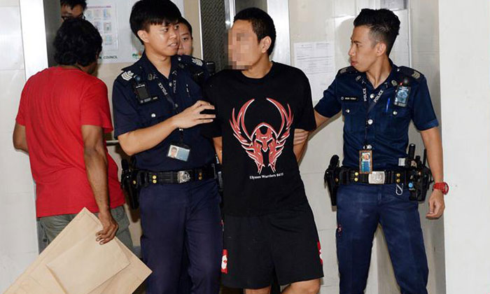 Photo: Shin Min Daily News. The 31-year-old son was calm during the time of arrest.