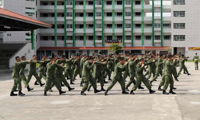 Recruits training in a square at the Basic Military Training Centre on Pulau Tekong. ST PHOTO: ALPHONSUS CHERN