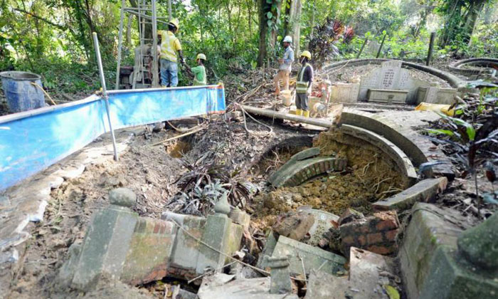 A machine operator's lapse in judgement during train tunnelling works and ground conditions contributed to a tomb caving in earlier this month at the Mount Pleasant Chinese Cemetery within Greater Bukit Brown. PHOTO: SHIN MIN DAILY NEWS