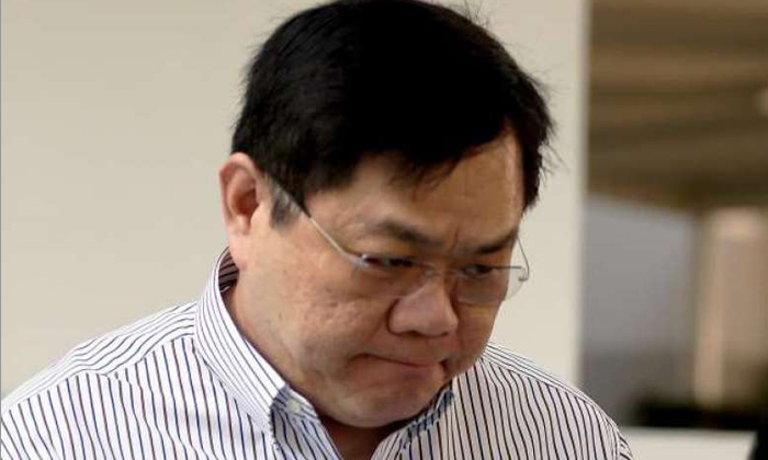 Clarence Chang Peng Hong, 51, BP Singapore's former eastern regional director for marine fuels, was hauled to court on Thursday (March 9) to face 47 charges including 20 counts of obtaining about US$4 million in bribes. ST PHOTO: WONG KWAI CHOW