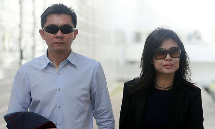 IT manager Tay Wee Kiat was sentenced to 28 months' jail and his wife Chia Yun Ling was sentenced to two months' jail. ST PHOTO: WONG KWAI CHOW