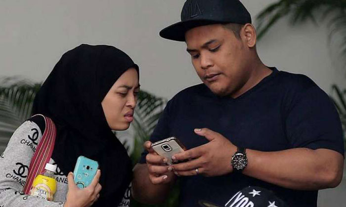 Siti Norhaizah Abdullah (left) was sentenced to six weeks' jail and Rahmat Jumari (right) was sentenced to nine months' jail for causing hurt to Muhammad Abdul Latip.ST PHOTO: WONG KWAI CHOW