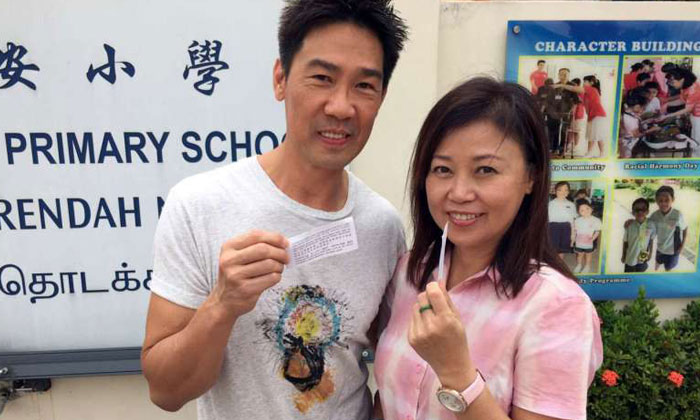 Local actor Edmund Chen, pictured here with his wife Xiang Yun in 2015, confirmed with The Straits Times that he has filed a police report.PHOTOS: EDMUND CHEN, FACEBOOK, LOLLIPOP