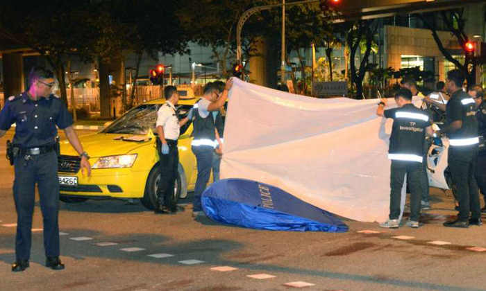 A 49-year-old taxi driver was arrested on Sunday (April 9) night after he drove into a foreign worker, who died on the spot. PHOTO: SHIN MIN DAILY NEWS