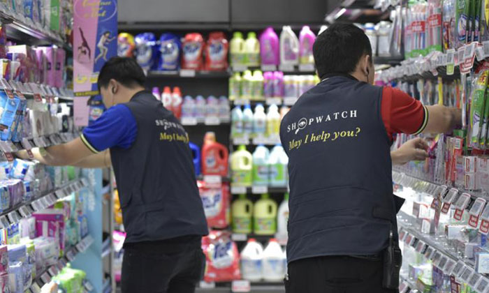 """A Sheng Shiong staffs wearing vests that says """"SHOPWATCH, May I Help You?""""PHOTO: THE STRAITS TIMES"""