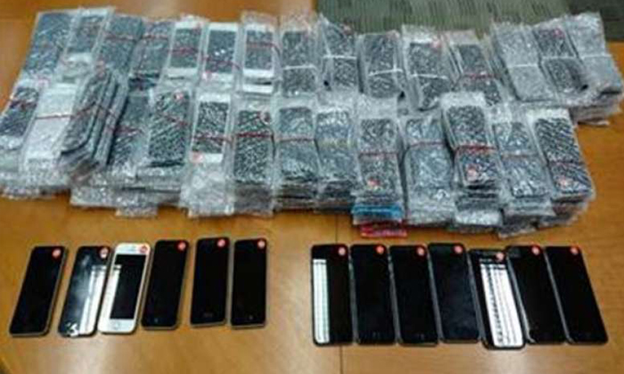Counterfeit mobile phones seized in a 10-hour raid on April 11, 2017. PHOTO: POLICE & SINGAPORE CUSTOMS