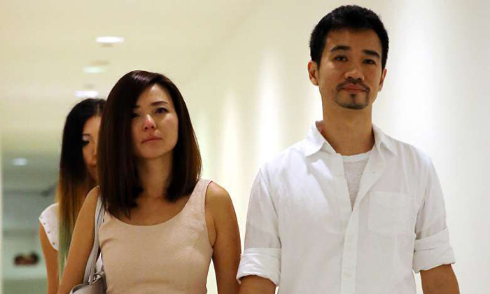 """Serina Wee (left) and her husband Kenny Low (right) leaving the court. The judges noted that the case should not be seen as a """"sinister and malicious attempt"""" by the six to use the church's funds for their own purposes, despite the huge sum of about $50 million involved.ST PHOTOS: WONG KWAI CHOW, DESMOND FOO"""
