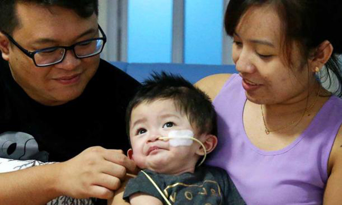 The Lims and baby Vanden, who is fed through a nasojejunal tube. TNP PHOTO: GAVIN FOO