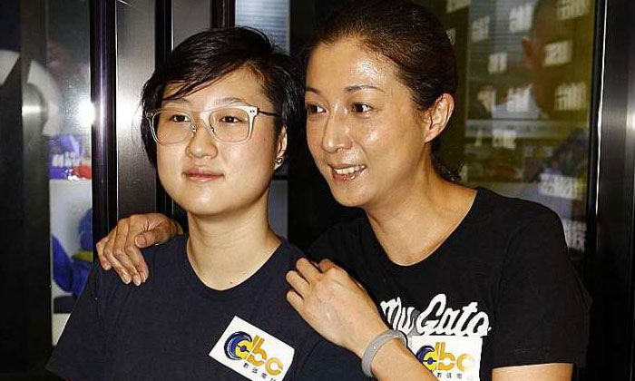 Elaine Ng with daughter Etta (both above) in a file photo. PHOTO: APPLE DAILY