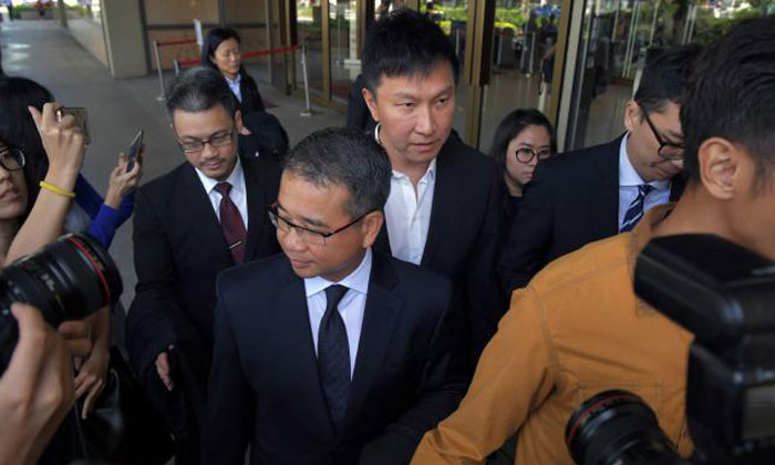 City Harvest Church (CHC) founder and senior pastor Kong Hee (centre) leaving the Supreme Court last Friday with his lawyer, Mr Edwin Tong, in front of him. Kong has said through his lawyer that he will study the filing by the Attorney-General's Chambers carefully before considering the next move. Photo: ST