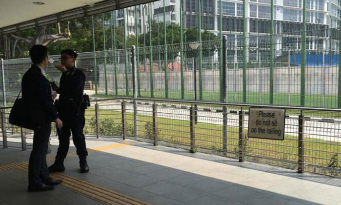 Two policemen standing near the area where three bags were left unattended at Aljunied MRT station. TNP PHOTO: ISABELLE LIEW