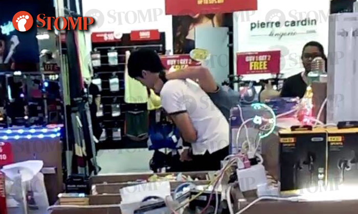 The man in white helped to subdue a thief (in blue).