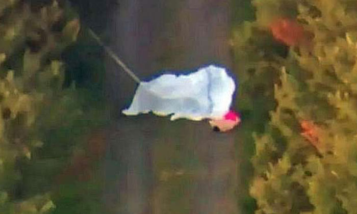 Photo: 7 News. One of the deceased lying on the ground, with parachutes having been deployed.