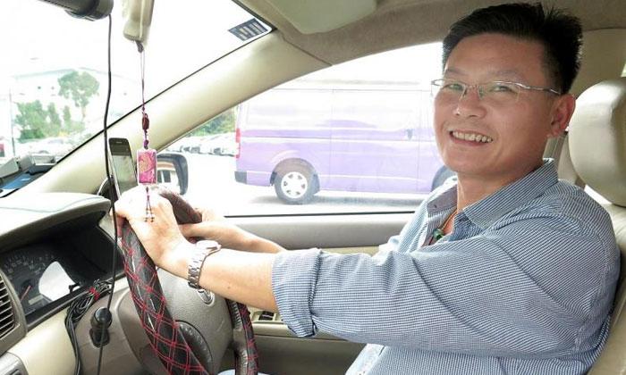 Mr Er Keh Joo has been driving for Grab for four years.TNP PHOTO: HARIZ BAHARUDIN