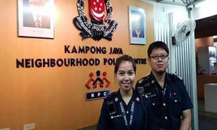 Inspector Loh Loong Ee (left) was attending to a case of suspected vice activity together with Staff Sergeant Xavier Seow when the attempted bribe occurred. Photo: Singapore Police Force