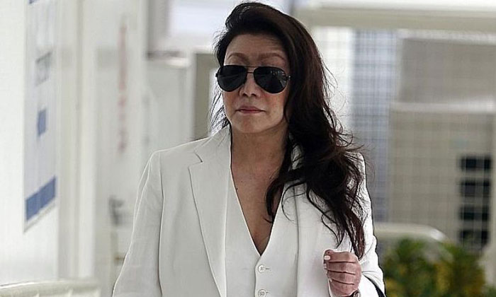 Shi Ka Yee arriving at the State Courts yesterday. Shi, who is currently out on bail, was found guilty of assaulting a male motorist in Telok Ayer Street on Feb 25, 2014. ST PHOTO: WONG KWAI CHOW