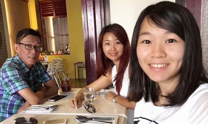 Ms Carmen Mark (right), with her mother Ariess Tan and father Mark Kok Wah. PHOTO: MARK KOK WAH