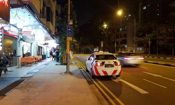 The photo of the police car parked next to a parking enforcement camera was posted on Facebook. PHOTO: FACEBOOK/CINOROM ELICEBMI