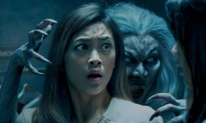 Miss Yeung Pui Man plays Malice (above, in costume) at Halloween Horror Nights.PHOTO: RESORTS WORLD SENTOSA