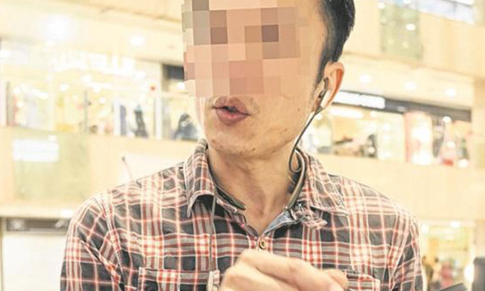 Mr Chen (in the photo) asked for a refund as he was unhappy that the watch kept malfunctioning. Photo: Lianhe Wanbao