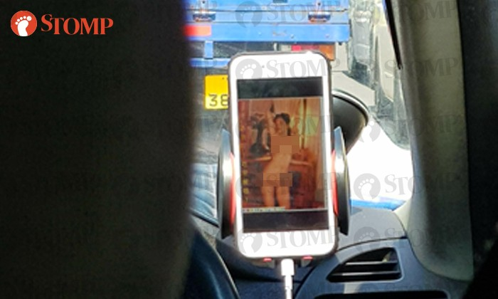 The first thing Stomper Roy noticed was a nude image of a woman on the taxi driver's phone