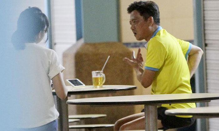 Mr Dominic Neo (right) talking to a a reporter.