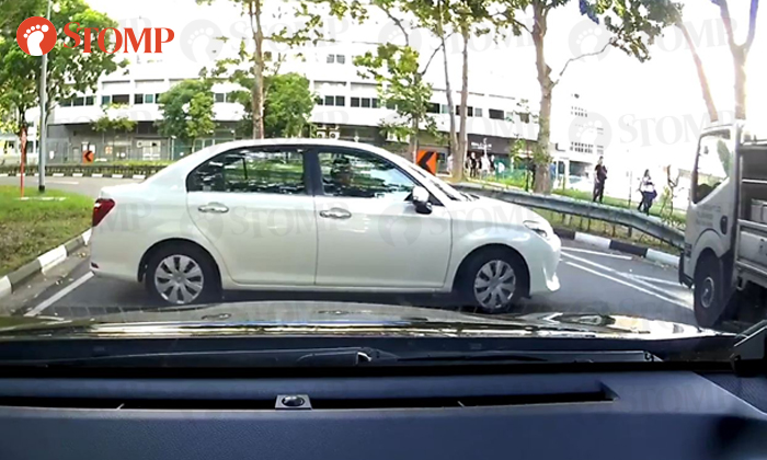 A driver was spotted reversing near a zebra crossing at Eunos before making a U-turn to drive against the flow of traffic.