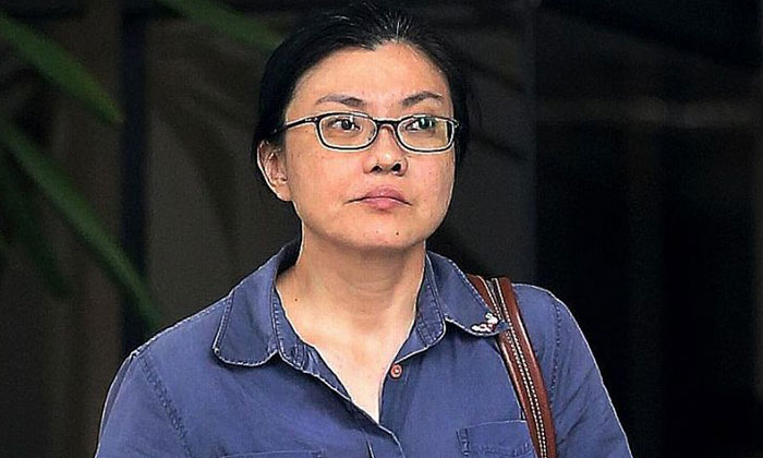 Koh Sock Buay was jailed 14 weeks for dishonestly misappropriating $26,822 and trying to bite a police officer's hand.ST PHOTO: WONG KWAI CHOW